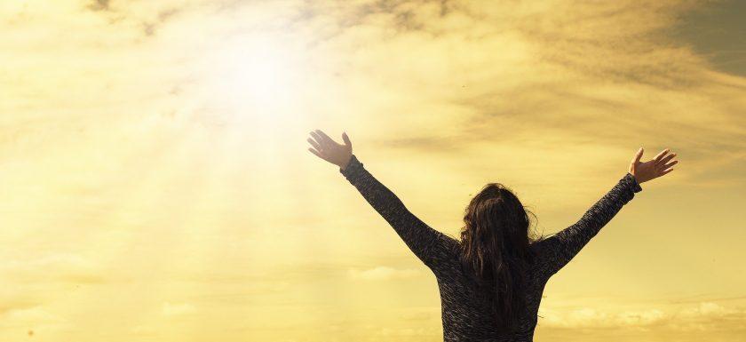 woman welcoming the morning sun